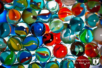 A shot of Trevor's marbles.  Two layers of marbles in a glass dish with lights from above and below.