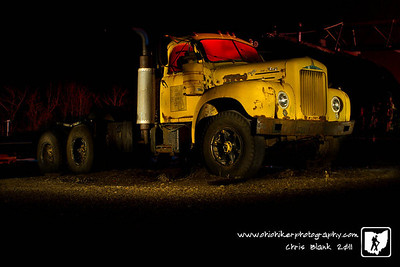This abandoned Mack truck sits over at the Gallia County Garage.  I have seen it sitting over there and love the look of it.  I have always enjoyed Troy Paiva's work with abandoned vehicles.  So with my large spotlight I headed out tonight to capture this Mack Truck.  This is a combination of 7 20 second exposures each lighting a different area of the truck.