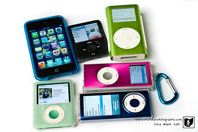 Needless to say we have a few iPods around the house.  The first iPod we had is the green Mini.  The battery will no longer hold a charge  but it does work.  The black Nano is my old one that the pause play button is not functioning and was replaced with the Touch that Steph got me for Christmas.  Steph's Nano is in the pink case. Trevor's is the green Nano and Isaac's is the blue Nano.