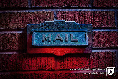 The mail usually means one thing anymore, bills.  So after a failed attempt for another shot tonight and getting a few bills today.  I grabbed a red gel for a flash, propped the mail box lid open and tried to make the mail box look evil.  Maybe it will keep the bills away, or not.