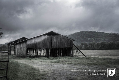 With another rainy and gloomy afternoon, I stopped on my way home to photograph this barn.  The rain had just stopped and the clouds beginning to break up when I stopped. This old barn has seen better days and has not appeared to have been used in many years.
