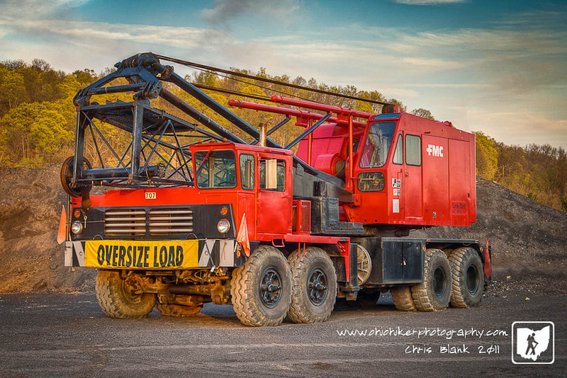 This Linkbelt crane had the evening off at the County Engineers office.  I was walking around close to the station this evening enjoying the warm weather when the crane was sitting in among the piles of rocks.  It was waiting for the next days work while the evening sun cast the last bit of light.