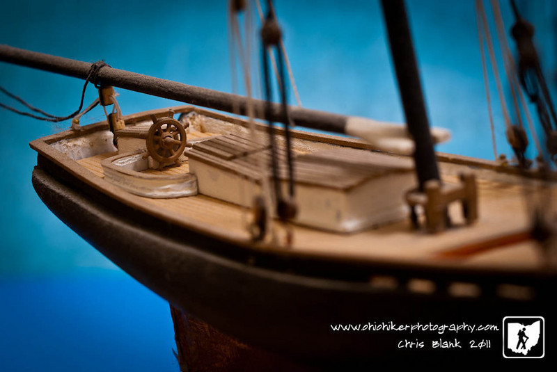 After watching Voyage of the Dawn Treader with Trevor tonight I was trying to come up with something to photograph.  That is when I remembered this model ship I built several years ago.  I set it up with some of Steph's scrapbook paper for a background.