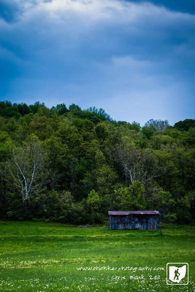 Trevor had soccer in Albany today, so afterwards we came back via back roads to look for some landscapes to photograph.  Just outside of Harrisonville in Meigs County I spotted this lonely barn back in a field against a treeline.  The clouds were just moving in and the rain started soon after this.