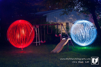 This evening I heard a strange noise in the backyard.  When I went out to investigate I saw these two glowing orbs hovering around the swings.  Luckily they stayed around long enough for me to grab a quick photograph.  Hopefully I will get to see them again!