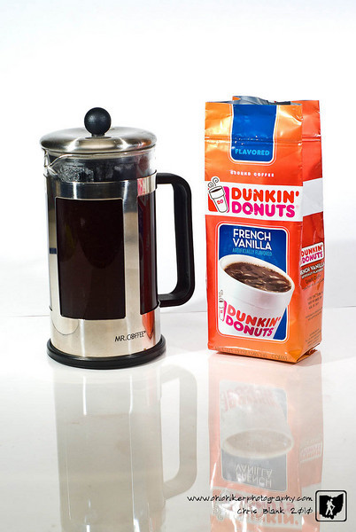 I am not a big coffee person, but I enjoy Dunkin' Donuts Coffee.  So as I was getting up this morning I setup this shot with my bag of Dunkin' Donuts Coffee and my Coffee press.