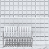 Metal Bench Against Concrete Squares