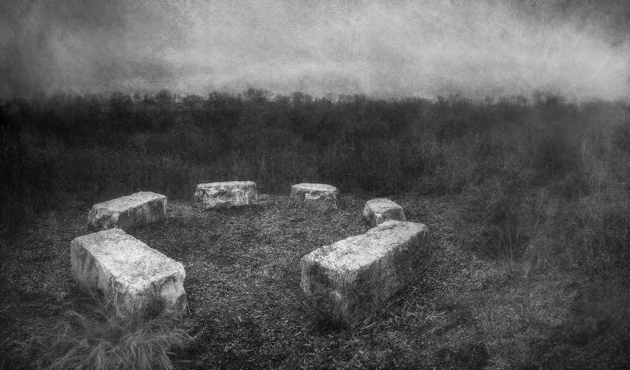 Through the damp, cold, winter fog, the narrow path led up to the top of the hill. In the clearing, sat a small stone circle.