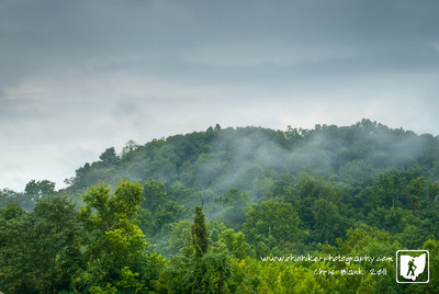 Well not a moutian but a hill.  After heavy rains last night and this morning a light layer of mist was clinging to the trees around some of the hills.  With more rain expected the last day of the Gallia County Fair looks like it will be a muddy one.