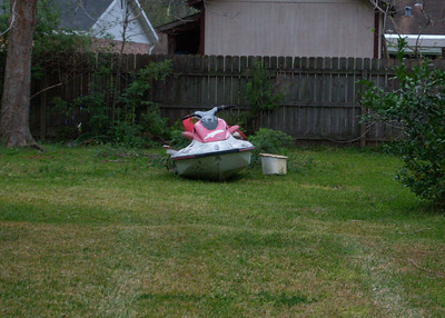 9/365 ~ 3/9/09 Jerry's Jet Ski sitting in the yard after he GAVE away the trailer.