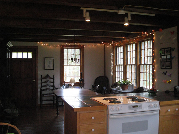 View from the kitchen, looking towards dining room. The design is intentionally open, to allow for easy interaction between the cook and his or her guests.