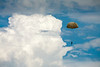 Parachute jumper against dramatic sky