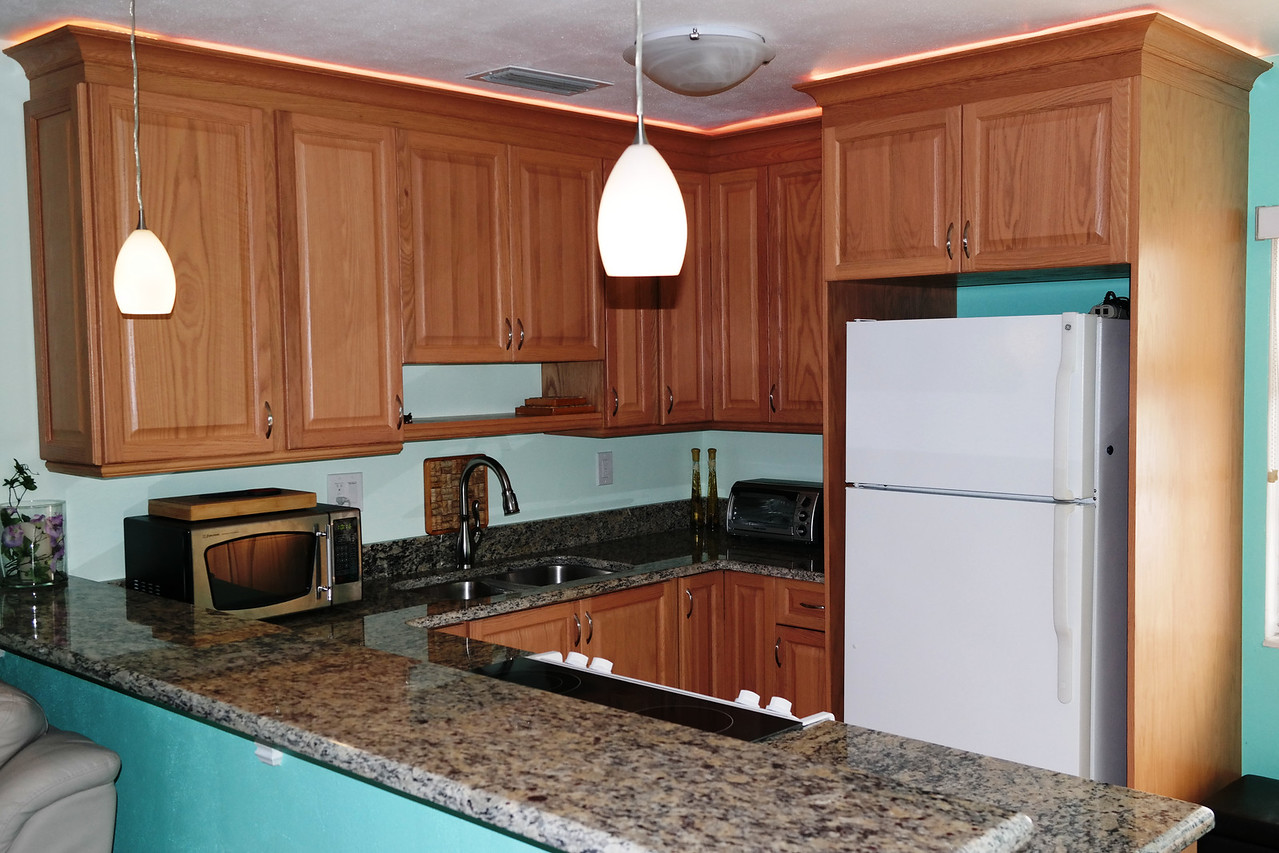 Notice the L.E.D. lighting above the cabinets, the color can be varied or brightened or dimmed.
