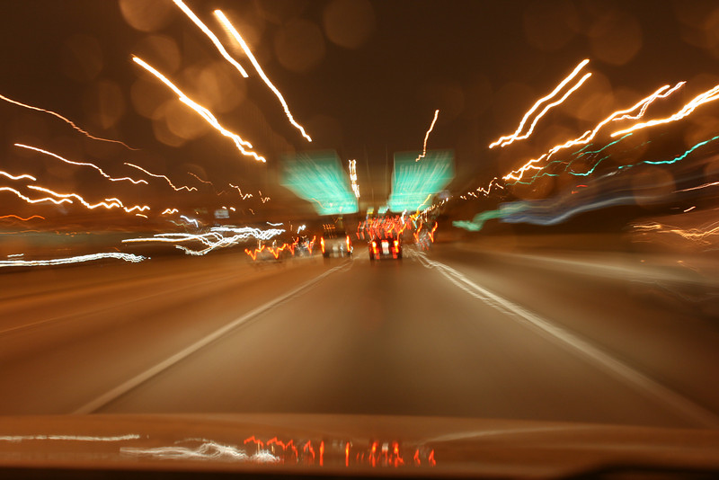 Day 53 ~ Ridin' Shotgun<br /> <br /> On the way home from the city I put my camera on the dashboard of the car and set the time exposure for about 4 seconds.  Not sure what I was going to get I hit the shutter and was pretty pleased with the outcome.  I had a number of really neat shots and had a hard time deciding which one to post.  There were also some neat ones where there was a curve in the road and the lighting followed (for you budding photographers that want to try your hand at something a little more abstract and original).