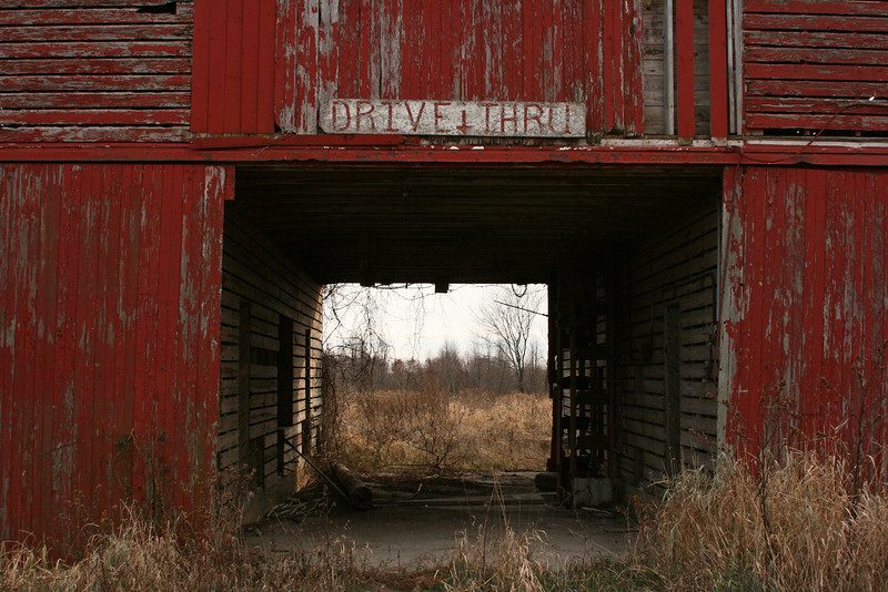 "Day 126 ~ Drive Thru<br /> <br /> Rather than running out and shopping on ""Black Friday"" we take the slower pace and drive along the road less traveled.  We pull over to take pictures of this abandoned barn that still has a lot of character for it's age.  The ""Drive Thru"" sign definitely caught my eye."