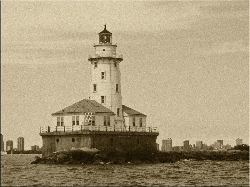 Day 60 ~ Lighthouse by DuSable Harbor<br /> <br /> Again, playing around with Photoshop, I took this photo that was lacking nice color, made it black and white, added a sepia filter and then added a noise filter to make the photo look older than it really is.  This picture was taking during a sailing lesson with Third Coast Sailing over the summer.