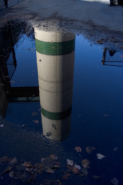 <CENTER>Reflection of water tower from puddle of water</CENTER>