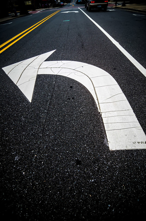 painted direction arrow on pavement