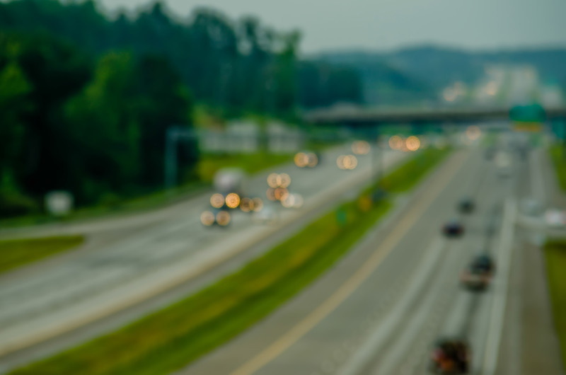 highway traffic near a big city out of focus