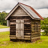 old wood log cabin in forest