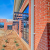brick building architecture with suncreen shades on windows
