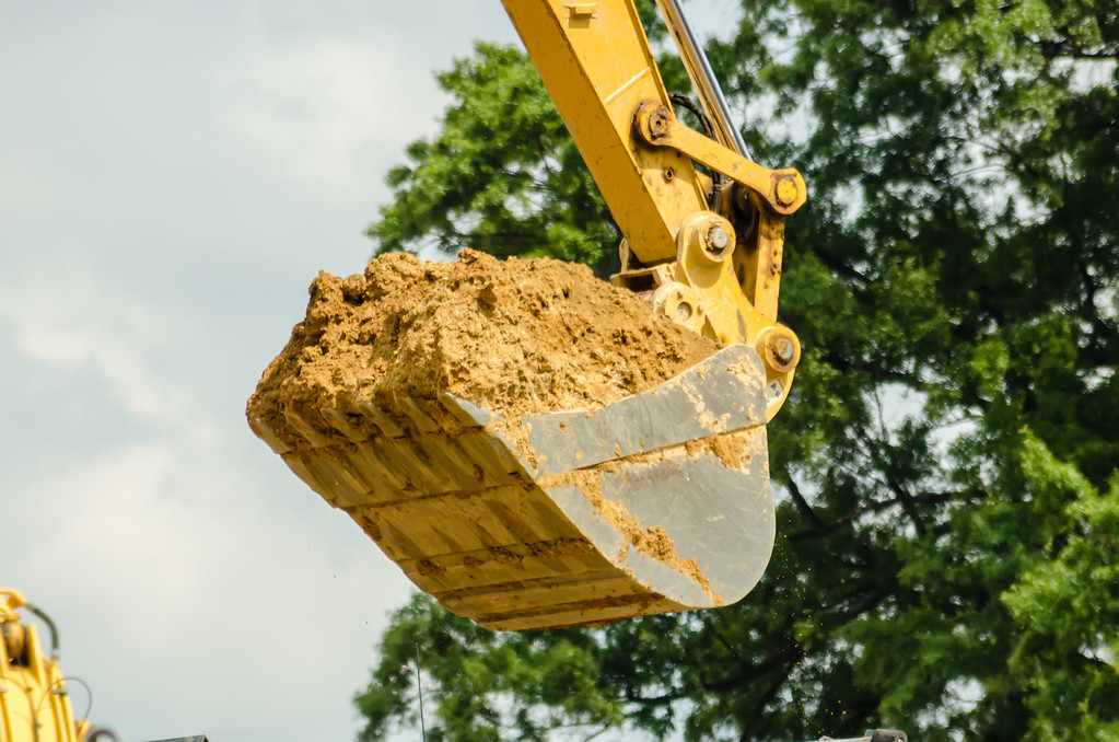 backhoe scoop of dirt