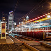 Charlotte City Skyline night scene with light rail system lynx train