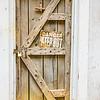 old wooden door with danger sign