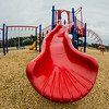 at a playground with a red slide