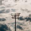 Stadium lights turn on at twilight time