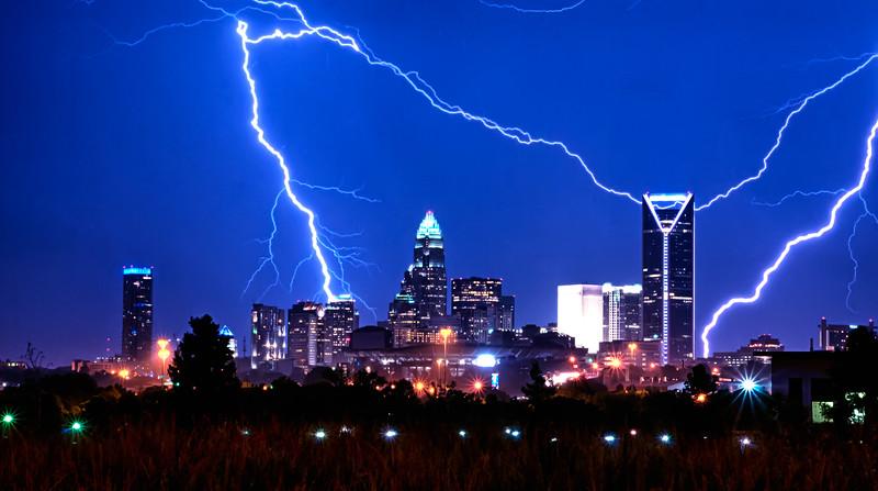 lightning strikes over charlotte skyline