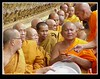 MONKS  - palace grounds Bangkok Thailand..waiting for an annual blessing ceremony that is attended by members of the Thai royal family.. This was made with a Sony Mavica FD 91 a 1 megapixel digital from 1999..one of the early innovative ones with video..It had a great 14X optical zoom + a digital zoom..which is the equivalent of 500mm  .. The longest lens avail on any digicam at that time ! I went for optics as opposed to res ! Unfortunately I was travelling and did not have enough diskette with me ..and I shot too low a res..big mistake