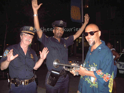 HELD UP BY THE HORN- Another night of music on the island..Tex was really in the groove and he was on fire  playing stuff from his Blakey days and new stuff as well..my buddies officers Knapp and Wright (the jazz cops!) from the local force were hanging out as usual..I saw Tex fooling with them and voila ...I got this set up ..thank you Finepix 4700 for letting me adjust flash