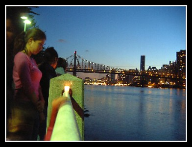 EMPTY RIVER The day after 9/11/2001..we were blown away..the day before you would have seen the WTC in the background..this was the spontaneous community gathering and mouring ..candles were lit and floated on the river