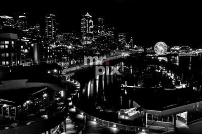 Seattle's 12th Man and the Great Wheel, in Black & White. Architectural Photography by Michael Moore. #seattleharbor #bigwheel #thegreatwheel #seattlewaterfront #seattleseahawks #gohawks
