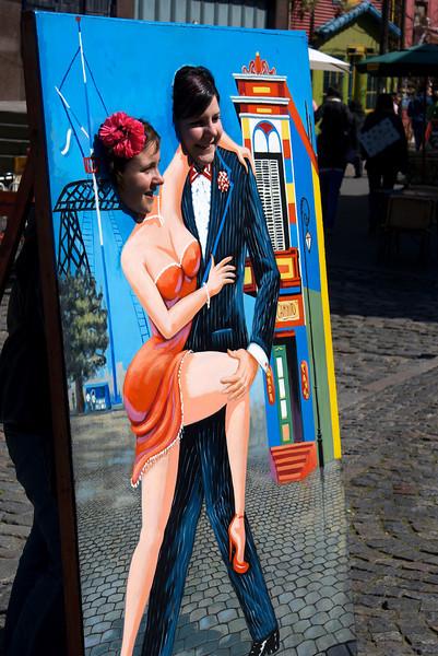 BUENOS AIRES. LA BOCA. TOURIST TAKING TANGO PICTURES.