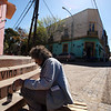 BUENOS AIRES. LA BOCA. POET PAINTING HIS POEM IN LA BOCA.