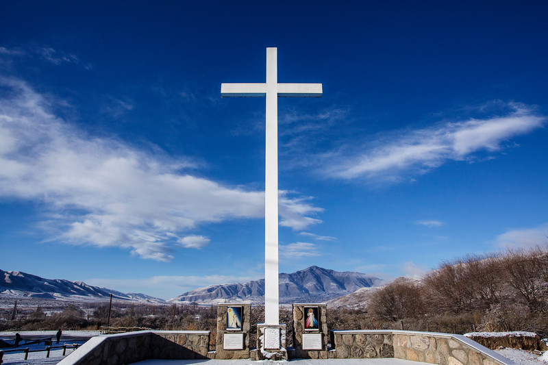 White cross surrounded by the Andes mountains in Tafi del Valle, Calchaquí Valley, Tucuman, Argentina, South America