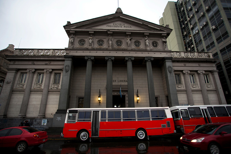 BUENOS AIRES CAPITAL. SCHOOL AND A RED BUS. MICRO CENTRO. BUENOS AIRES.