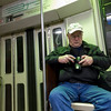 Week 3 - Portraits. Dad riding the green line.