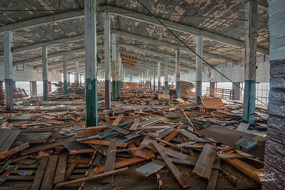 Once racks for storage, wood is scattered everywhere.    © John Schiller Photography