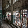 Looking through windows from one of many ramps that ran between floors of the buildings.  <br /> <br /> © John Schiller Photography