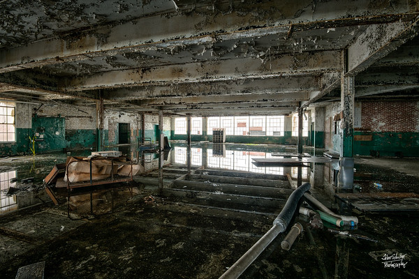 Look closely.  This room has lots of water on the floor.  What looks like floor joists is in fact ceiling joints reflecting in the water on the floor.    © John Schiller Photography