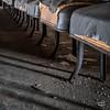 Window light casts evening shadows underneath the gym seats.<br /> <br /> © John Schiller Photography