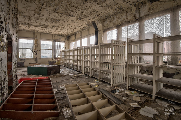 Storage room with lace covering windows.  © John Schiller Photography