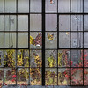 Broken glass and fall ivy mix together to create colorful collage.<br /> <br /> © John Schiller Photography