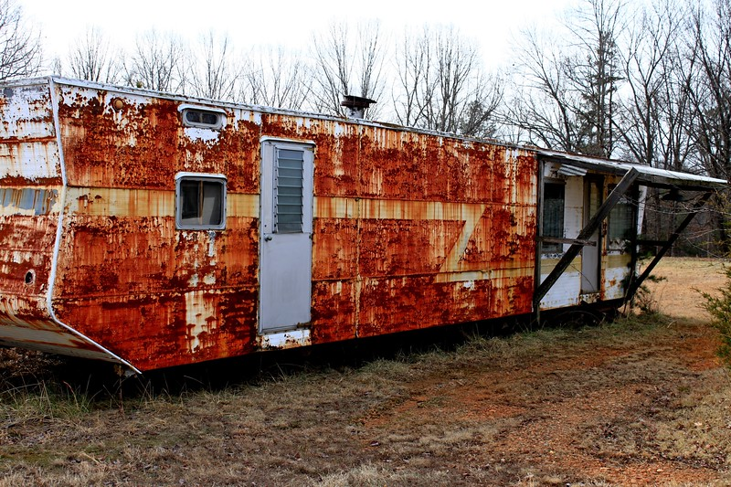 Abandoned trailer in front of the projection hut at East Bend Drive-In East Bend NC