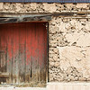 Barn door and adobe.