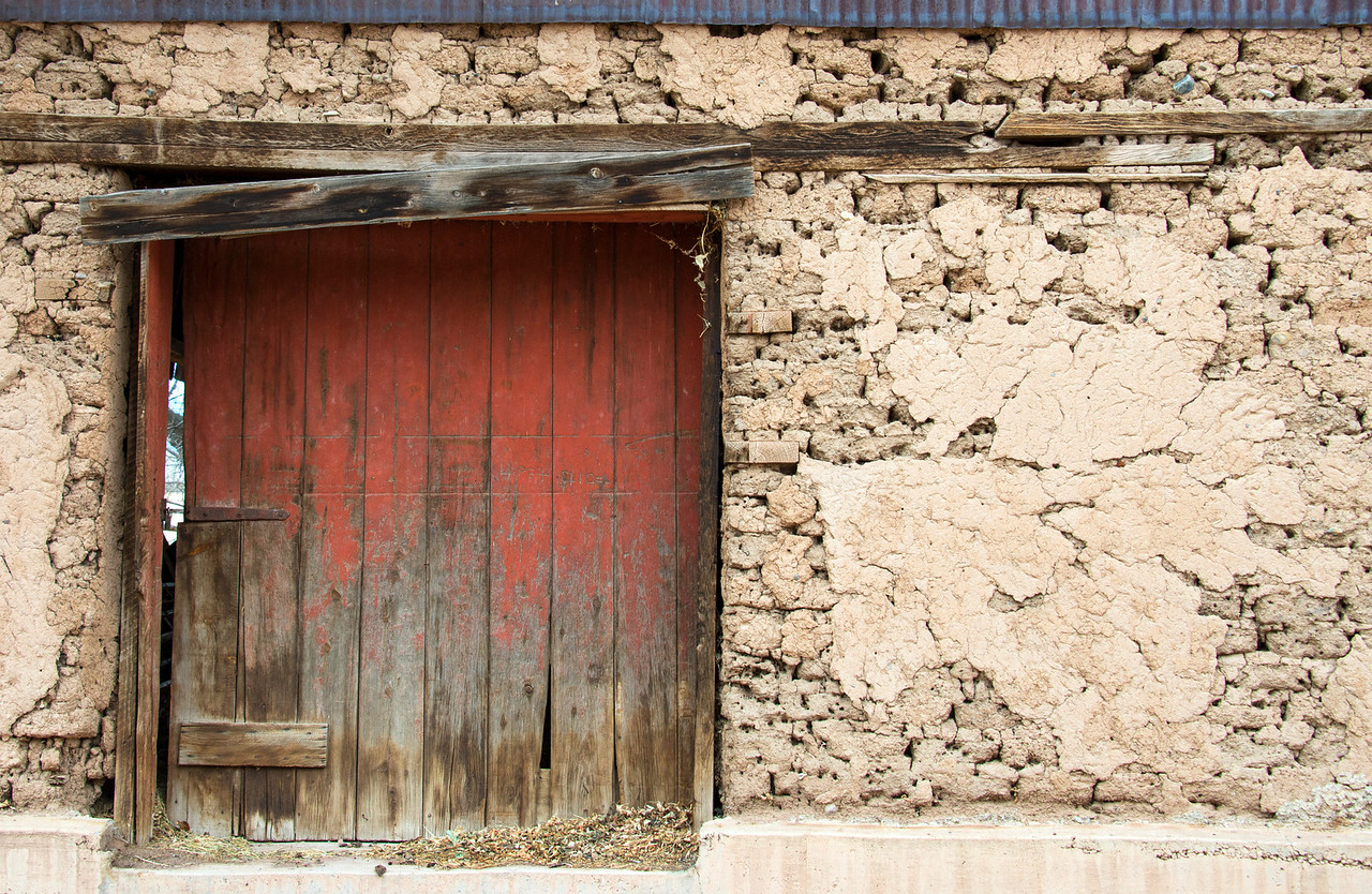 Barn door and adobe.