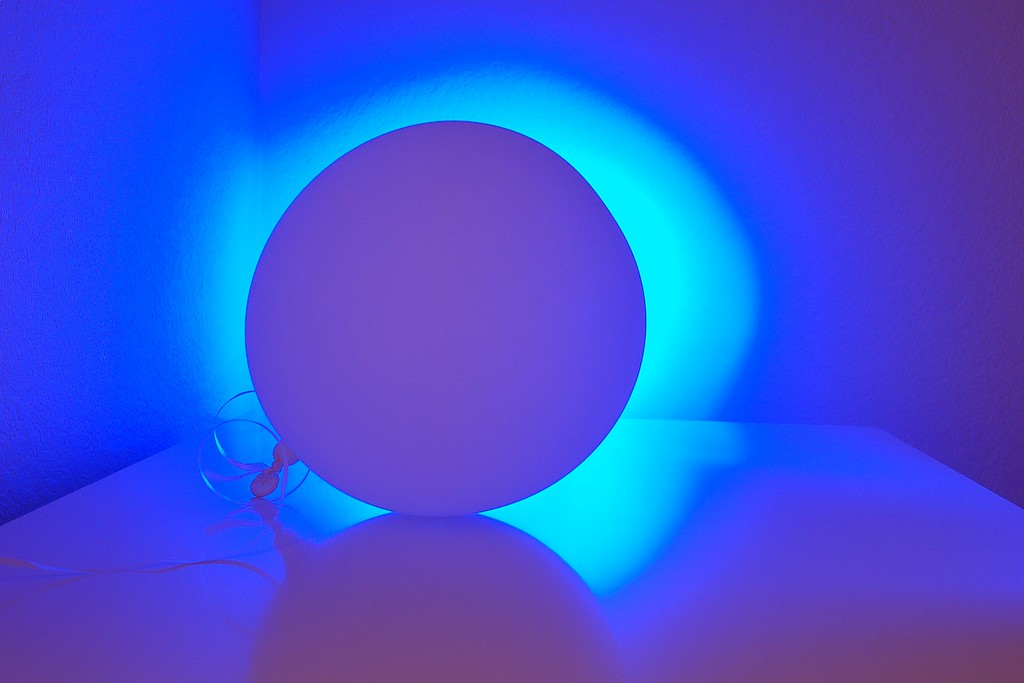 Light and Balloon- a white ballon is illuminated with blue led light